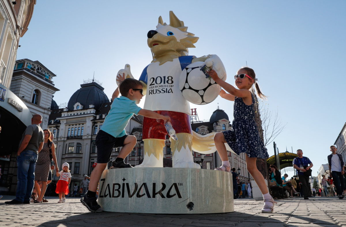 Children play around the FIFA World Cup official mascot Zabivaka