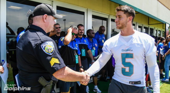 Miami Dolphins Kicker Greg Joseph meets with North Miami Beach Police Officer